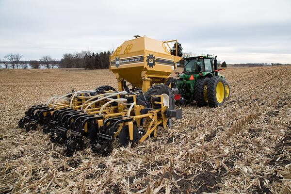 SoilWarrior 3100 strip tillage and nutrient placement system in high residue corn field